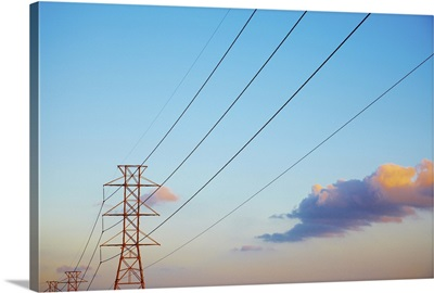 Power lines and blue sky with clouds