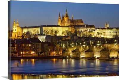 Prague - Charles Bridge, Hradcany Castle, St. Vitus Cathedral at dusk.
