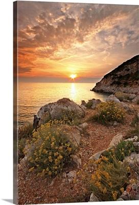 Punta Rossa beach at sunset in Italy.