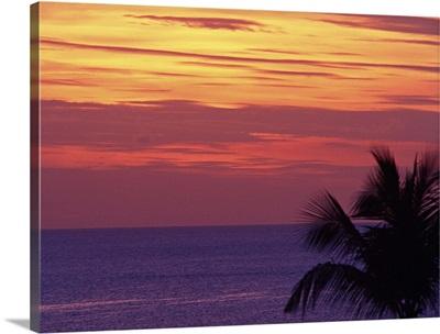 Purple sea with orange sunset