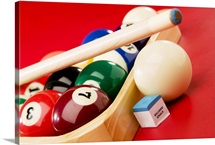 Racked pool balls and stick