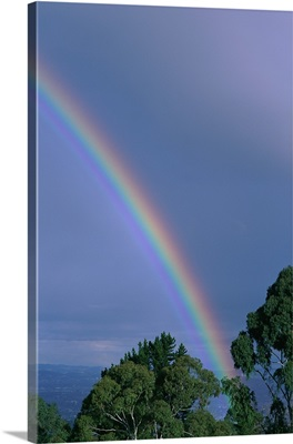 Rainbow over rocks