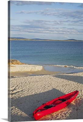 Red canoe on the beach, County Galway, Ireland