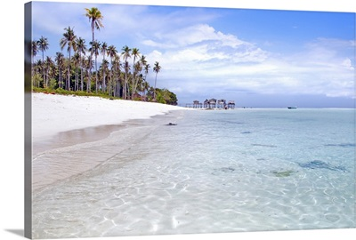 Remote island with beautiful sandy beach, crystal clear sea water and coconut tree.