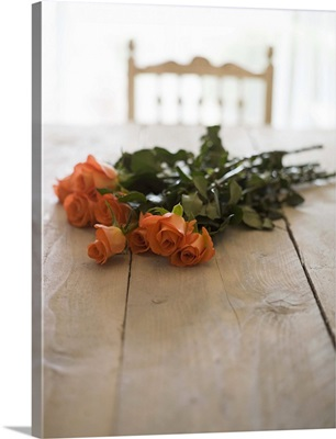 Roses on wooden table