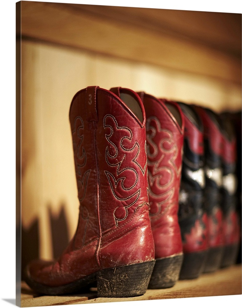 07e1e423960 Row of cowboy boots sitting on a shelf Wall Art, Canvas Prints ...