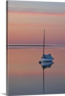Sailboat and buoy at sunset.