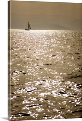 Sailboat in the Argolic Gulf near Naphlion in Greece.