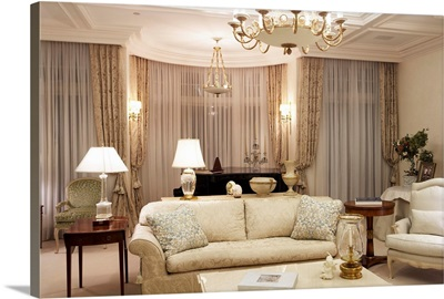 Showcase living room with a coffee table, lamps, and sofas