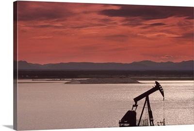 Silhouette of an oil derrick