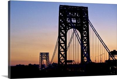 Silhouette of George Washington Bridge at sunset.
