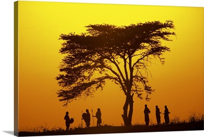 Silhouette of hunters on savanna in Africa