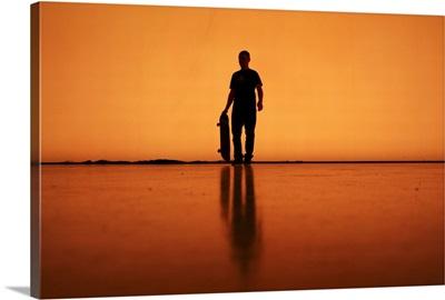 Silhouette of man with skateboard, Berlin.