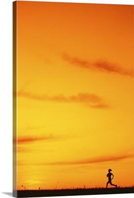 Silhouette of runner at sunset