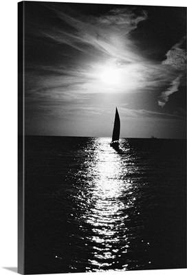 Silhouette of sailboat at sea