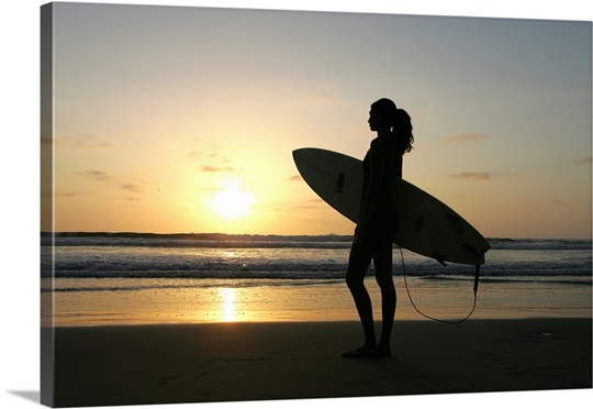 Silhouette of woman with surfboard by ocean at sunset Wall Art ...