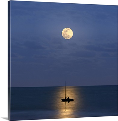 Silhouette sailboat with moon