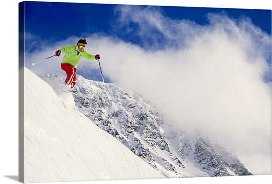 Skier flying over slope with clouds, Whistler Mount, Canada, low angle view