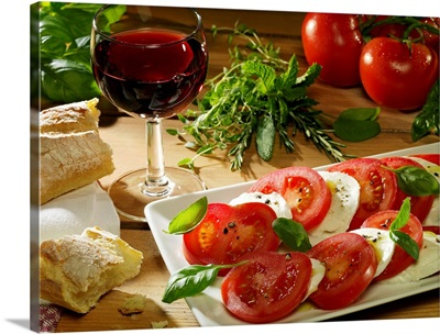 Slices of tomato and mozzarella on tray