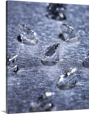 Small diamonds on metal surface, close-up (differential focus)
