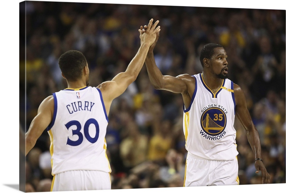 fbd4631ffc79 Stephen Curry 30 high-fives Kevin Durant 35 of the Golden State Warriors  Wall Art