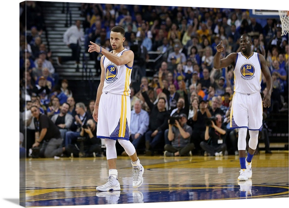 6ebb4f6a5db Stephen Curry and Draymond Green of the Golden State Warriors Wall ...