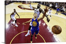Stephen Curry of the Golden State Warriors has his shot blocked by LeBron James