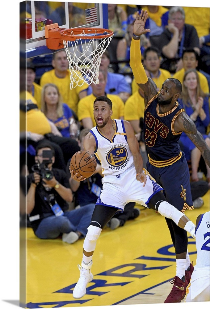 0304ab389173 Stephen Curry of the Golden State Warriors throws up a shot against LeBron  James Wall Art