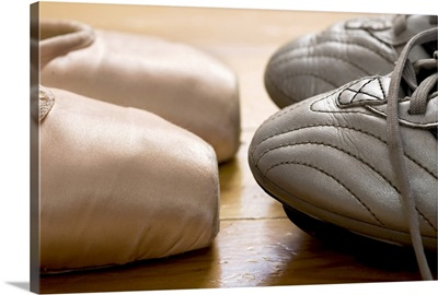 still life of ballet shoes and soccer cleats