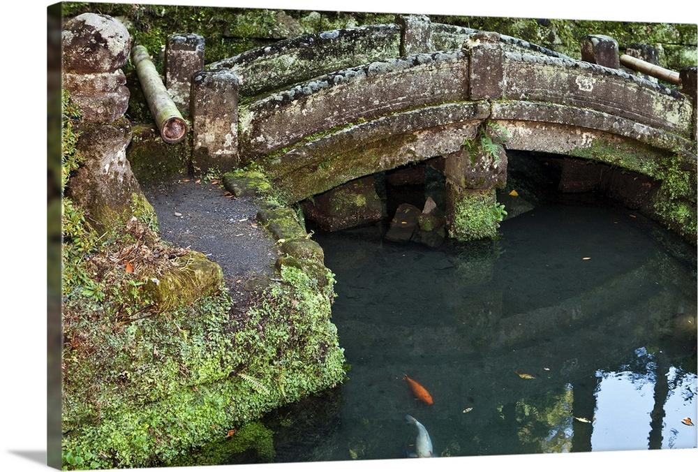 Stone Bridge Over Koi Pond