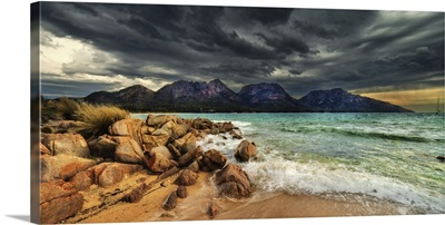 Storm clouds over mountains and beach