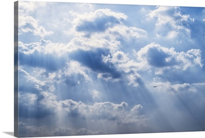 Sun rays beaming through the clouds