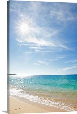 Sun with beach, Maui, Hawaii.
