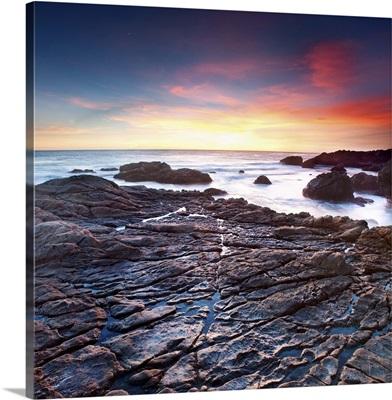Sunset on a rocky California beach, Malibu
