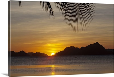sunset view of tropical islands from the beaches of corong corong