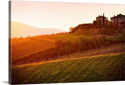 Sunsets over ideallic looking villa in Tuscanny, Italy.