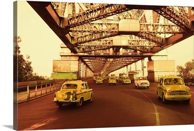 Taxis on a bridge, Howrah Bridge, Kolkata, West Bengal, India