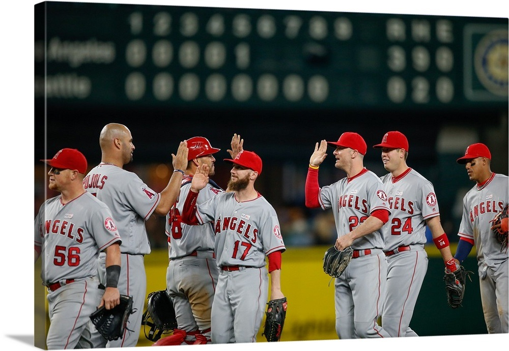 43c8710a2c8 The Los Angeles Angels of Anaheim celebrate after defeating the Seattle  Mariners Wall Art