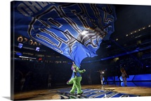 The Orlando Magic mascot waves a flag at the Amway Center before the game