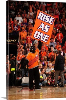 The Phoenix Suns mascot, Go Gorilla, holds up a sign
