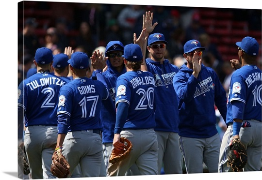 The Toronto Blue Jays celebrate after their victory over the Boston ...