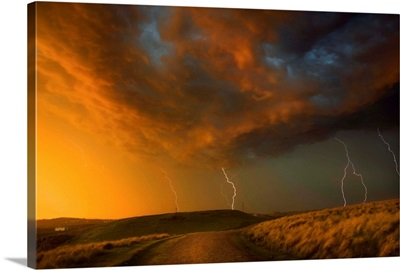 Thunderstorm And Orange Clouds At Sunset