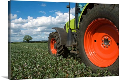 Tractor driving through crops