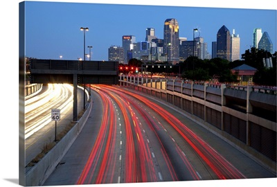 Trails of vehicle lights along US Highway, Dallas, Texas