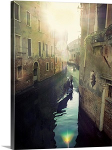 Two Gondolas Floating In Water Surrounded By Old Buildings