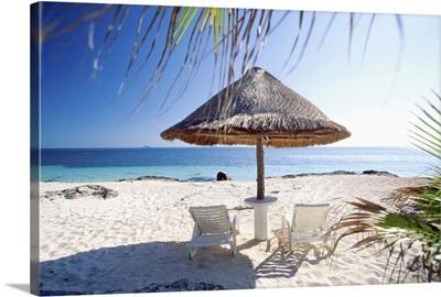 Umbrella and beach chairs