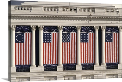 US Capitol Building with American flags draped between the columns