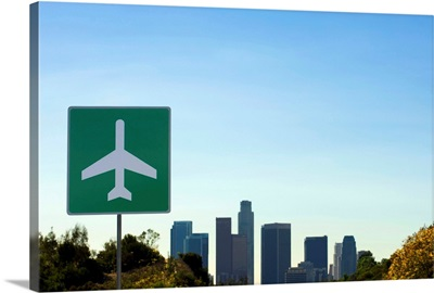USA, California, Los Angeles, airport sign with city skyline in background