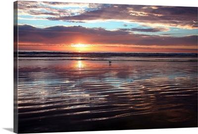 USA, California, Morro Strand State Beach, Sunset over the ocean