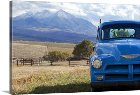 USA, Colorado, Carbondale, Blue vintage car, mount Sopris in ...